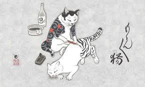 gato tatuando